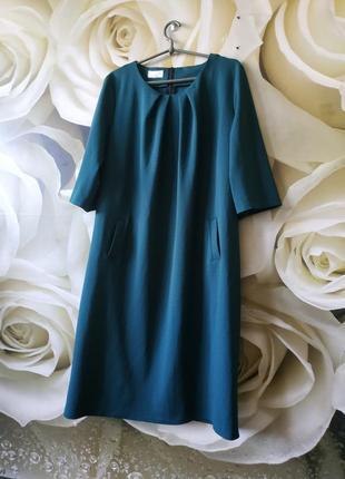 Миди платье свободного кроя с боковыми карманами
