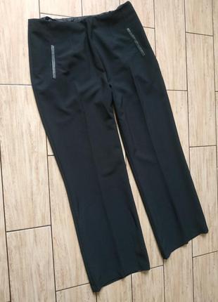 Стильные штаны свободного кроя палаццо-штаны