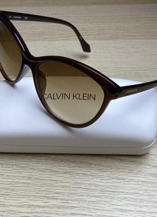 Calvin klein солнцезащитные очки коричневые