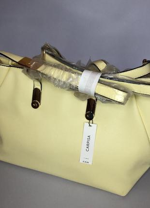 Светло-желтая сумка carpisa