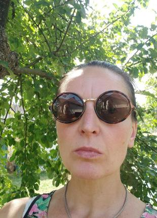 Очки, окуляри сонцезахисні