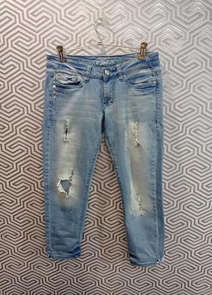 Стильные рваные джинсы calliope