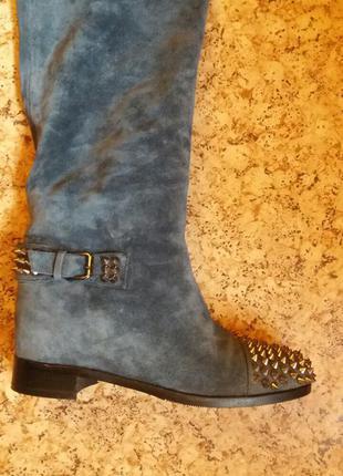 Зимние кожаные сапоги с декором шипов.25 см.mallanee.