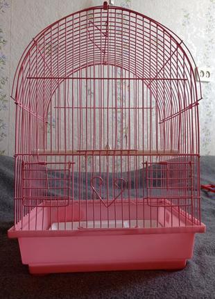 Розовая клетка для птицы