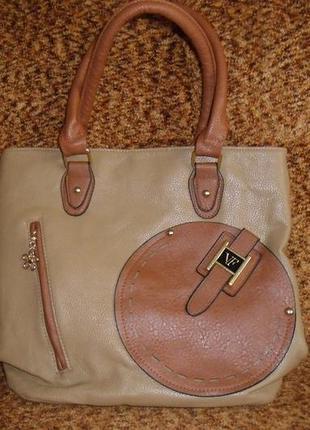 Красивая и практичная коричневая сумочка на каждый день