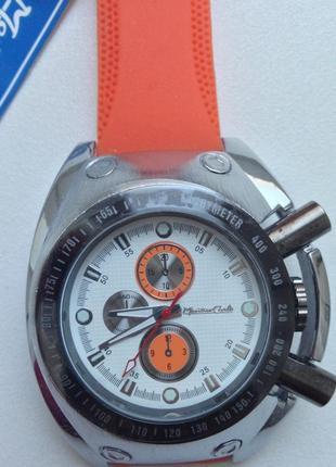 Часы montres carlo новые на оранжевом ремешке.