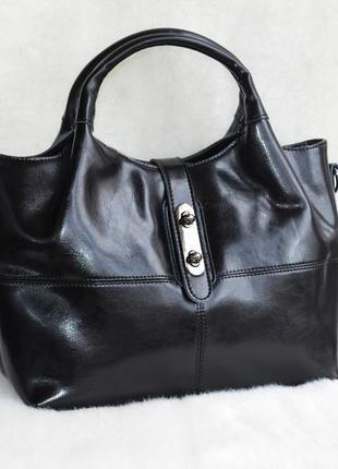 Кожаная стильная женская сумка.