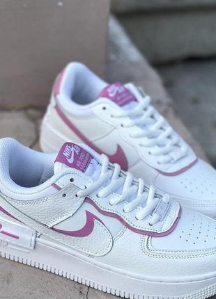Белые кроссовки кожаные с розовыми вставками