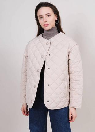 Стёганая куртка на кнопках
