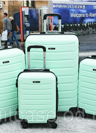 Дорожный чемодан производство fly мята