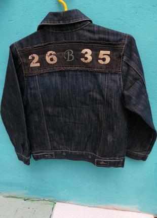 Джинсовый пиджак фирмы big nami темно-сининяя джинсовая ткань с надписью