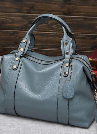 Женская кожаная голубая ручная сумка