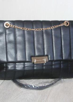 Стильная, стеганная сумочка.