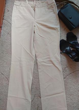 Бежевые брюки штаны