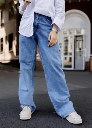 Современные джинсы клеш с высокой талией