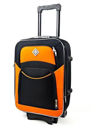 Средний тканевый чемодан черно-оранжевый на 5 колесах