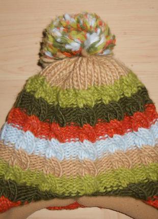 Цветная шапочка крупной вязки на 5-9 лет.
