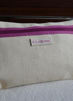 Clarins стильная косметичка.