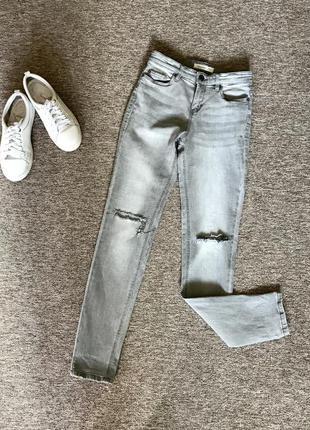 Сірі джинси скіні з високою талією calliope, з розрізами. серые джинсы скинни с завысшенной талией