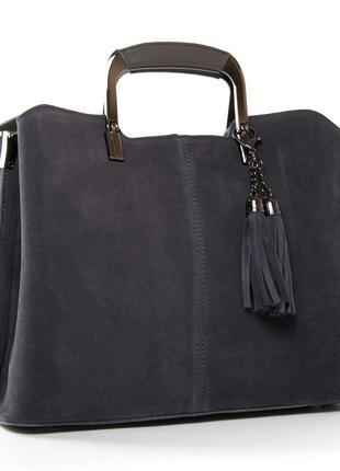 Женская сумка изготовлена из натуральной замши и кожи. три отделения