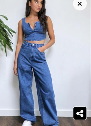 Новые! брендовые джинсовые брюки широкого кроя.