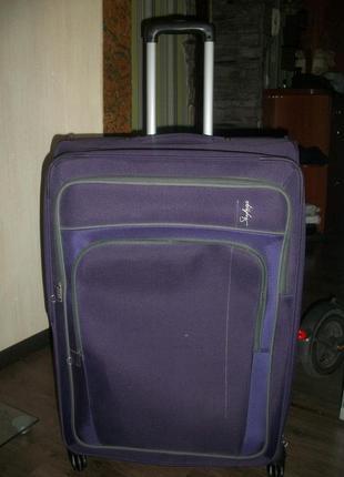 Крутой дорожный большой чемодан американского бренда skybags