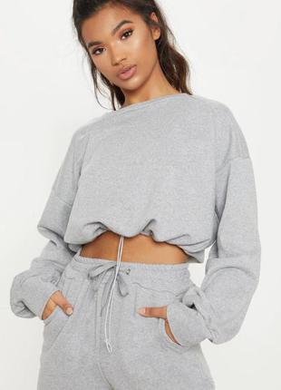 Сірий жіночий короткий светр топ