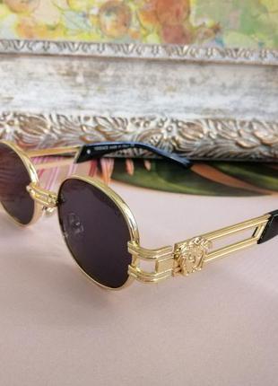 Стильные солнцезащитные женские округлые очки в металлической оправе 2021 с лого