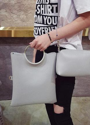 Стильная городская сумка с ручками кольцами и клатчем