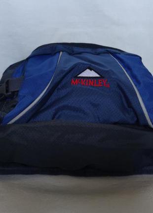 Яркая вместительная сумка на пояс mckinley.