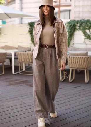 Стильные широкие брюки с высокой посадкой3 фото