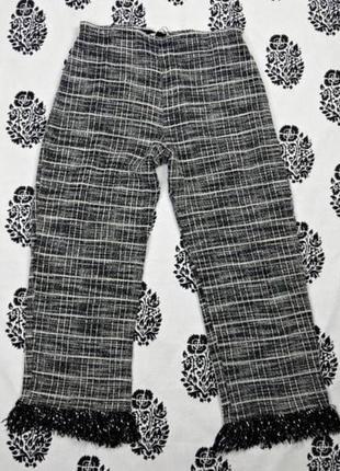 Твидовые брюки в клетку с оборкой zara