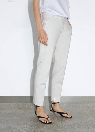 Бежевые брюки zara