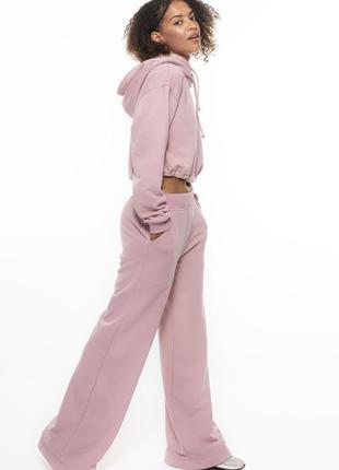 Брюки клеш розовый colo3 фото