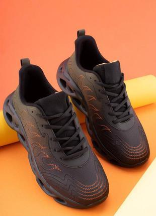 Чоловічі чорні кросівки з помаранчевими вставками
