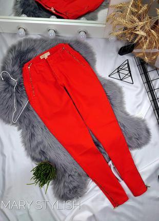 Оранжевые морковные яркие джинсы