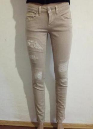 Тілесні котонові джинси (бежевые котоновые брюки)