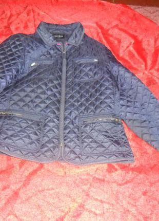 Стеганая курточка .