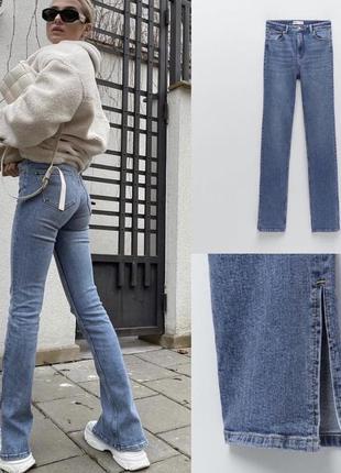 Голубые джинсы с разрезами zara. размер 32,34,36,38. в наличии.