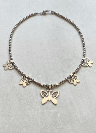Кольє з метеликами
