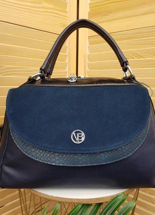 В наличии оригинальная синяя женская сумка боченок