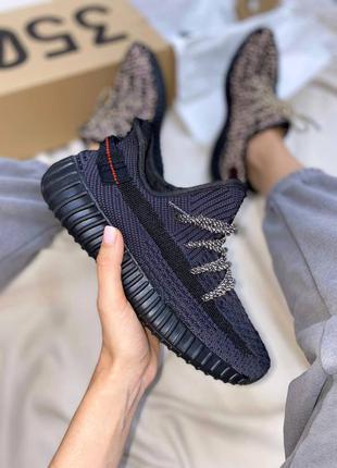 Топовые кроссовки адидас изи буст чёрные