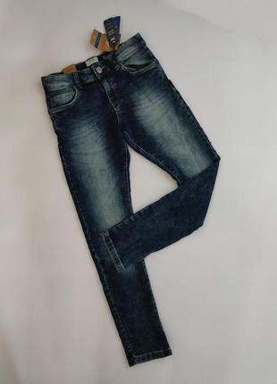 Темно-синие джинсы с потертостями ovs 140 / 146 см