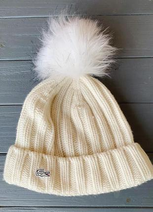 Белая шапка унисекс lacoste с помпоном оригинал