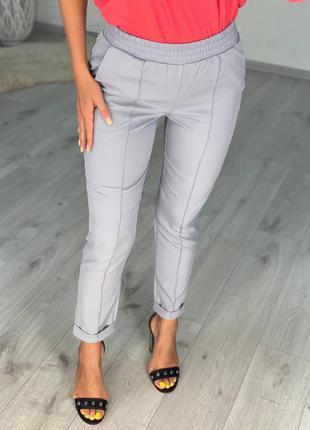 Женский брюки с карманами