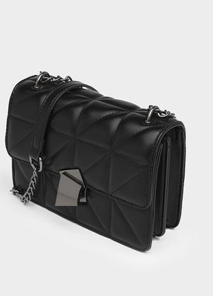 Женская кожаная чёрная стеганая сумка