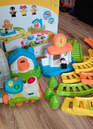 Железная музыкальная дорога поезд фирма weina для малышей крупные детали