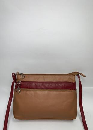 Кожаная фирменная актуальная сумочка на/ через плечо rosa benini.