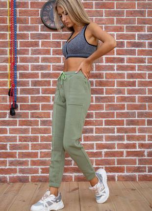Теплые спортивные штаны женские зеленые оливковые осенние жіночі спортивні штани теплі