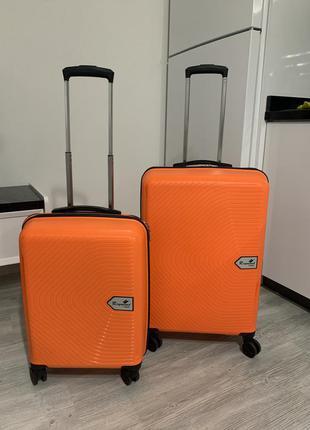 Чемодан силиконовый, модель 2021 года. легкий, ударопрочный и маневренный. цвет оранжевый.